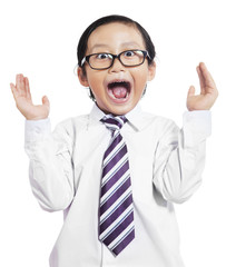Funny little boy with shocked expression