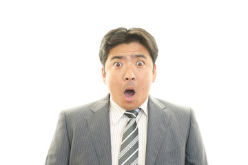 驚いた表情のビジネスマン