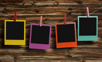 Color polaroids on a clothesline