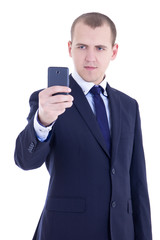 business man taking photos with mobile camera isolated on white