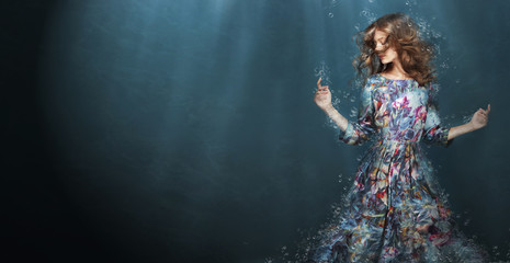 Immersion. Woman in Deep  Blue Sea. Fantasy