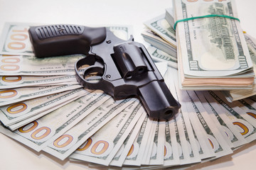 Gun with money on the table