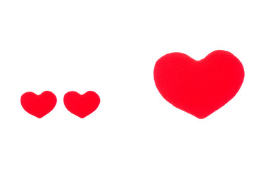 A small red heart and a big red heart on a white background