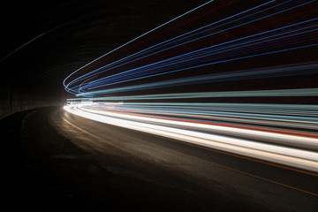 Abstract blue, yellow and white rays of light in a car tunnel Fotomurales