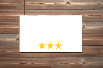 white canvas hanging in front of brown wooden wall three stars