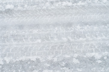 Close up of tire tracks on icy road