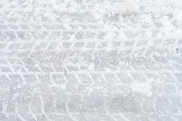 Close up of tire track on icy road