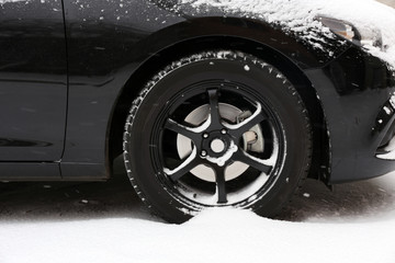 Black car covered with snow, outdoors