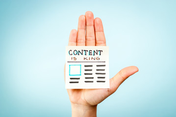 Hand with content is king message. Digital marketing subject.