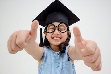 Happy Asian school kid graduate with big thumb up