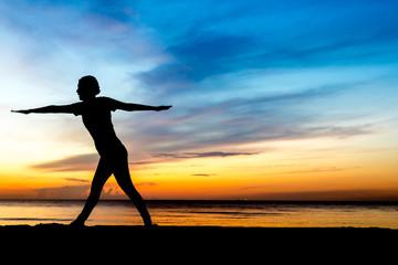 women playing yoga