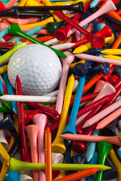 Various wooden golf tees and golf ball