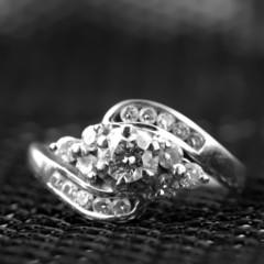 Diamond wedding rings on dark background