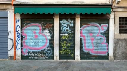 Closed shop with graffiti