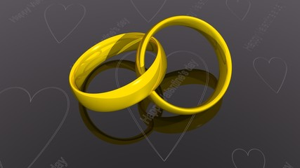 Two gold rings on a black surface for Valentine's day