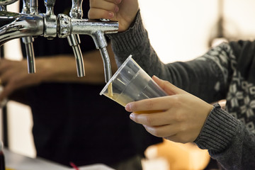 Keuken foto achterwand Bier / Cider Woman drawing beer from tap