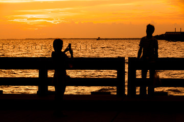 Couple of best friends on silhouette.
