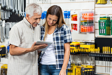 Family Using Digital Tablet In Hardware Shop