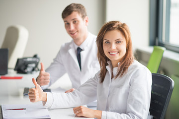 two doctors shows thumb up.