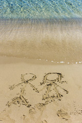 Drawing in the sand depicting love of the opposite sexes