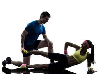 Wall Mural - woman exercising fitness workout with man coach silhouette