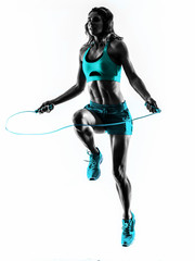 Fototapete - woman fitness Jumping Rope exercises silhouette