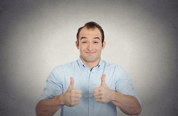 happy,excited surprised young man showing thumbs up