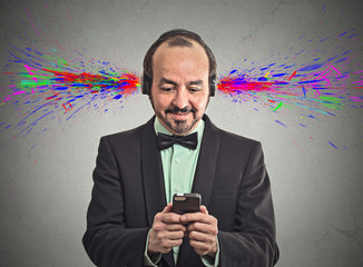 man listening music with headphones sound colorful splashes