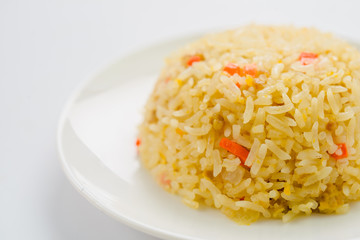 Rice and vegetables on a plate with a white background.