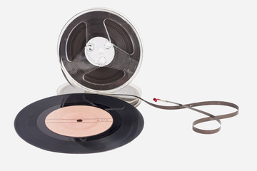 ancient audio reel tape and audio disc