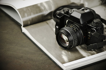 Vintage photo camera and photo book