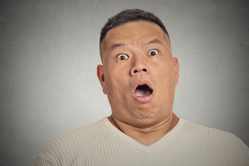 headshot shocked man isolated on grey wall background
