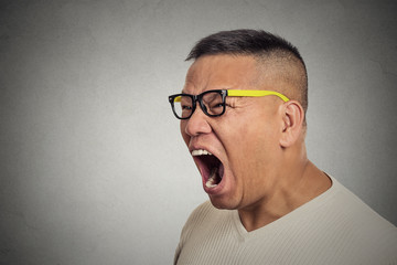 mad displeased angry man with glasses open mouth screaming