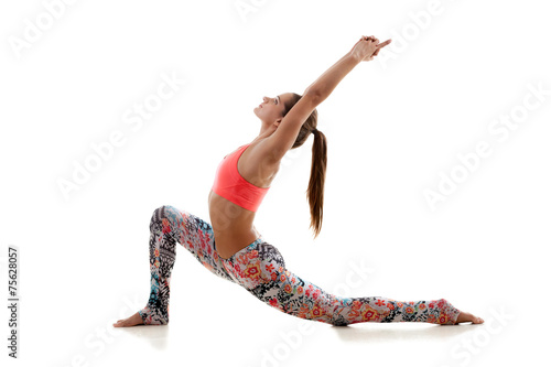 Men and women practicing yoga at home stock photo 12