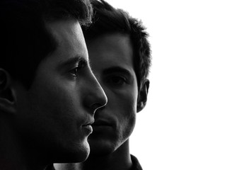 close up portrait two  men twin brother friends silhouette