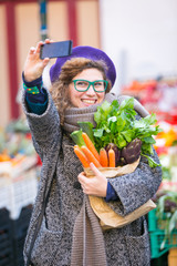 Young Woman Taking a Selfie at Vegetables Market
