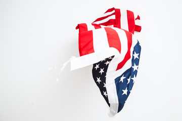 The fall of the flag of the United States. Falling leaf of a gre