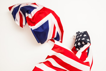 The fall of the United States and Great Britain. Falling flags o