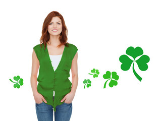 smiling teenage girl in green vest with shamrock