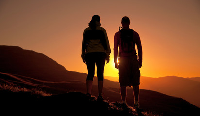 Couple Looking At The Sun