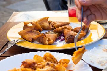 Detail of eating in Spanish tapas restaurant