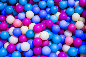 colored  plastic balls in the pool for children to play