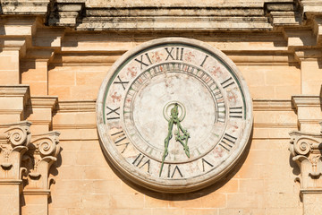 Old clock on St Paul cathedral in Mdina, Malta