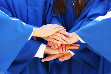Graduate students hands close-up