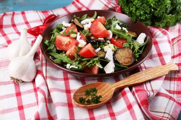 Eggplant salad with tomatoes, arugula and feta cheese,