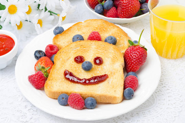 Breakfast with a smiling toast, fresh berries, jam