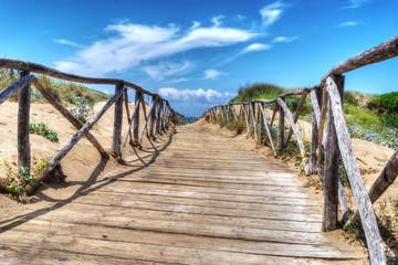 wooden boardwalk heading to the beach