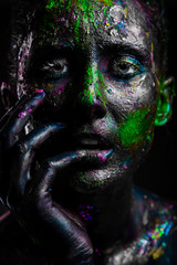 Girl with neon flicker on the face. Black face art.