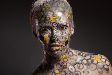 Woman female lizard. Body art and face art