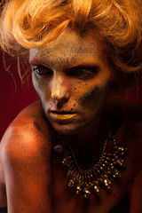 Magic Girl Portrait. Golden Makeup. Face art and body art.
